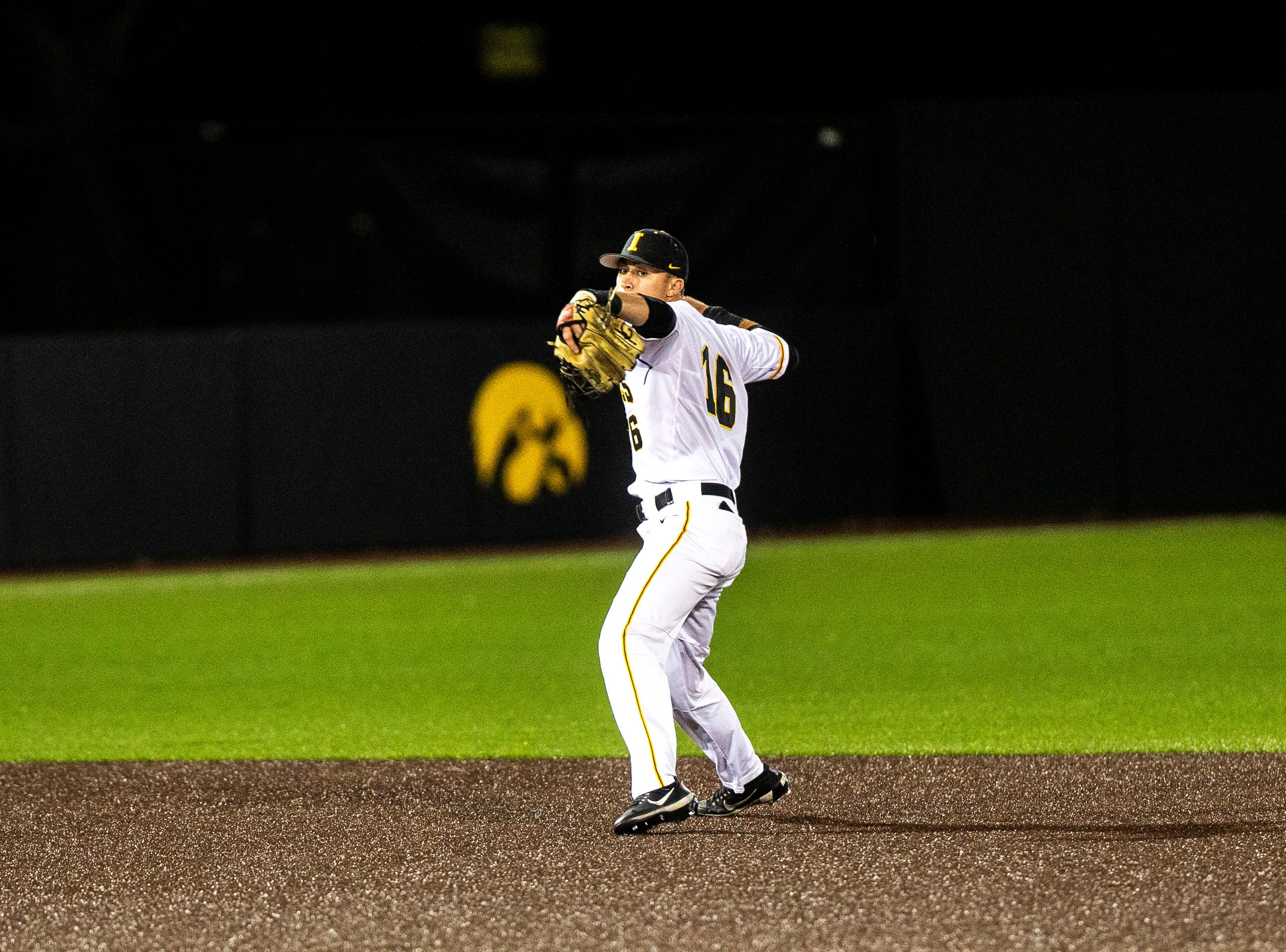 Iowa's Tanner Wetrich (16) throws a ball to first during NCAA non conference baseball game, Friday, May 3, 2019, at Duane Banks Field in Iowa City, Iowa.
