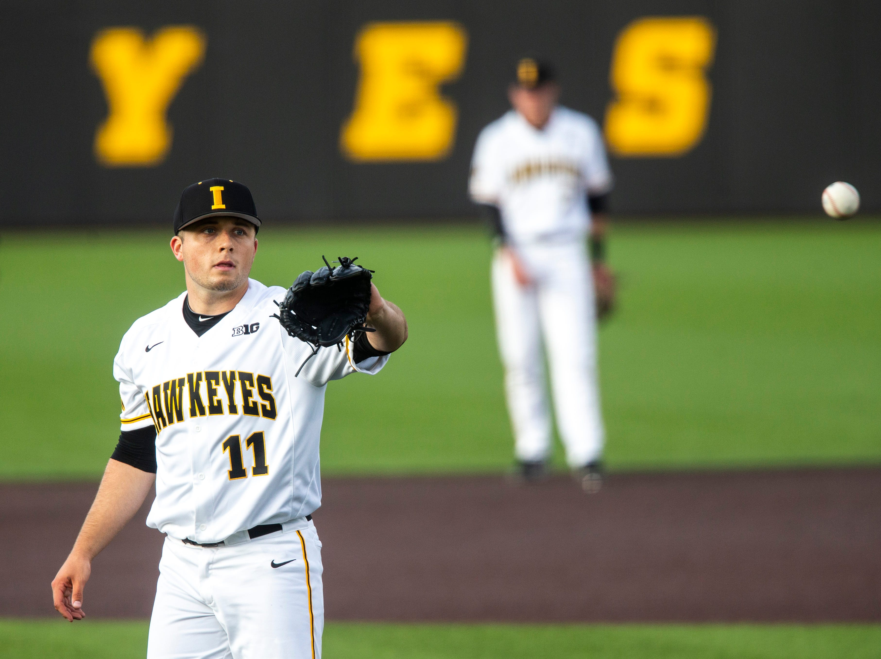 Iowa pitcher Cole McDonald (11) catches a ball on the mound during NCAA non conference baseball game, Friday, May 3, 2019, at Duane Banks Field in Iowa City, Iowa.