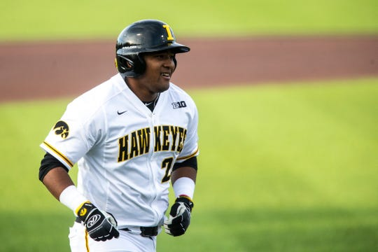 Iowa infielder Izaya Fullard (20) smiles while running towards home plate after hitting a home run during NCAA non conference baseball game, Friday, May 3, 2019, at Duane Banks Field in Iowa City, Iowa.