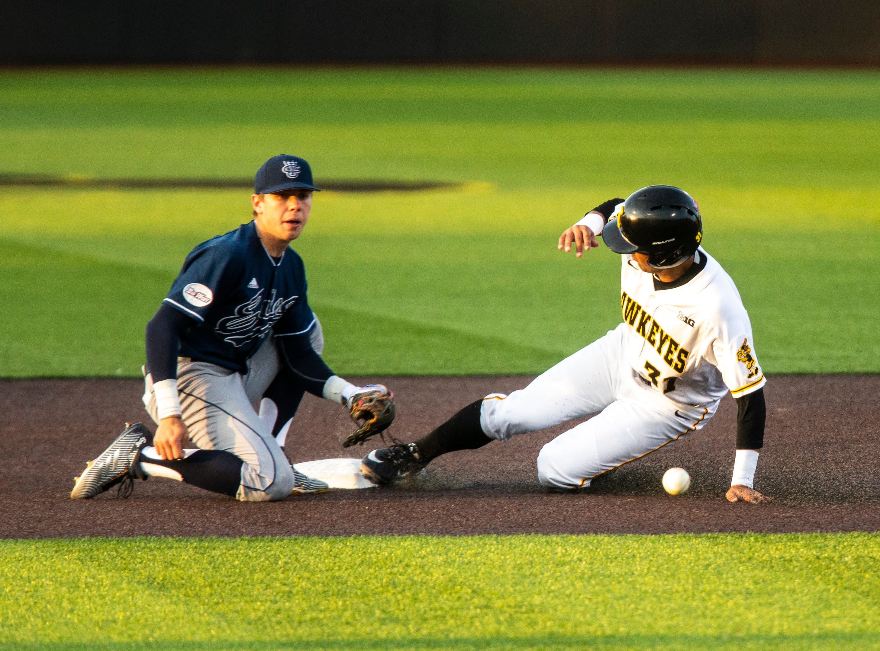 Iowa infielder Matthew Sosa (31) slides in to second ahead of a bouncing throw to University of California Irving's Christian Koss during NCAA non conference baseball game, Friday, May 3, 2019, at Duane Banks Field in Iowa City, Iowa.