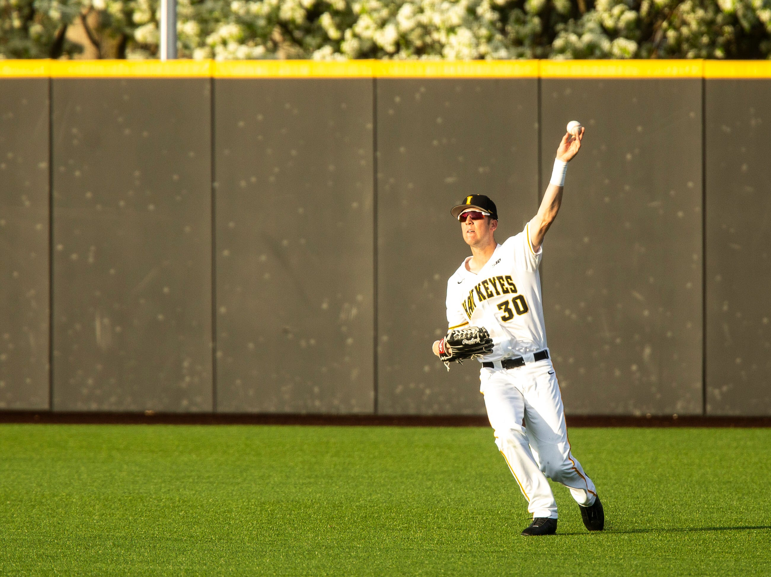 Iowa's Connor McCaffery (30) tosses a ball to the infield during NCAA non conference baseball game, Friday, May 3, 2019, at Duane Banks Field in Iowa City, Iowa.