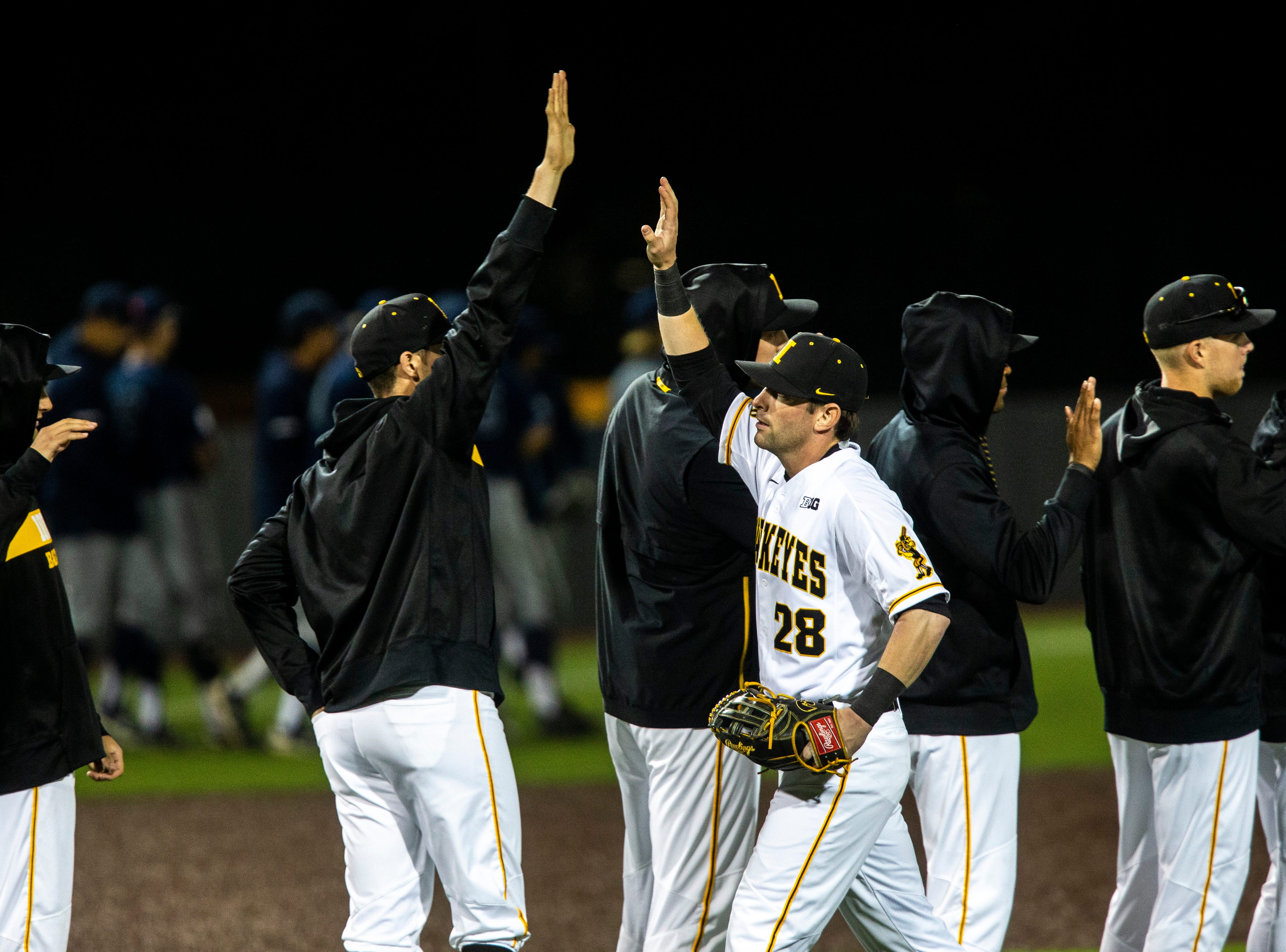 Iowa's Chris Whelan (28) high-fives teammates after NCAA non conference baseball game, Friday, May 3, 2019, at Duane Banks Field in Iowa City, Iowa.