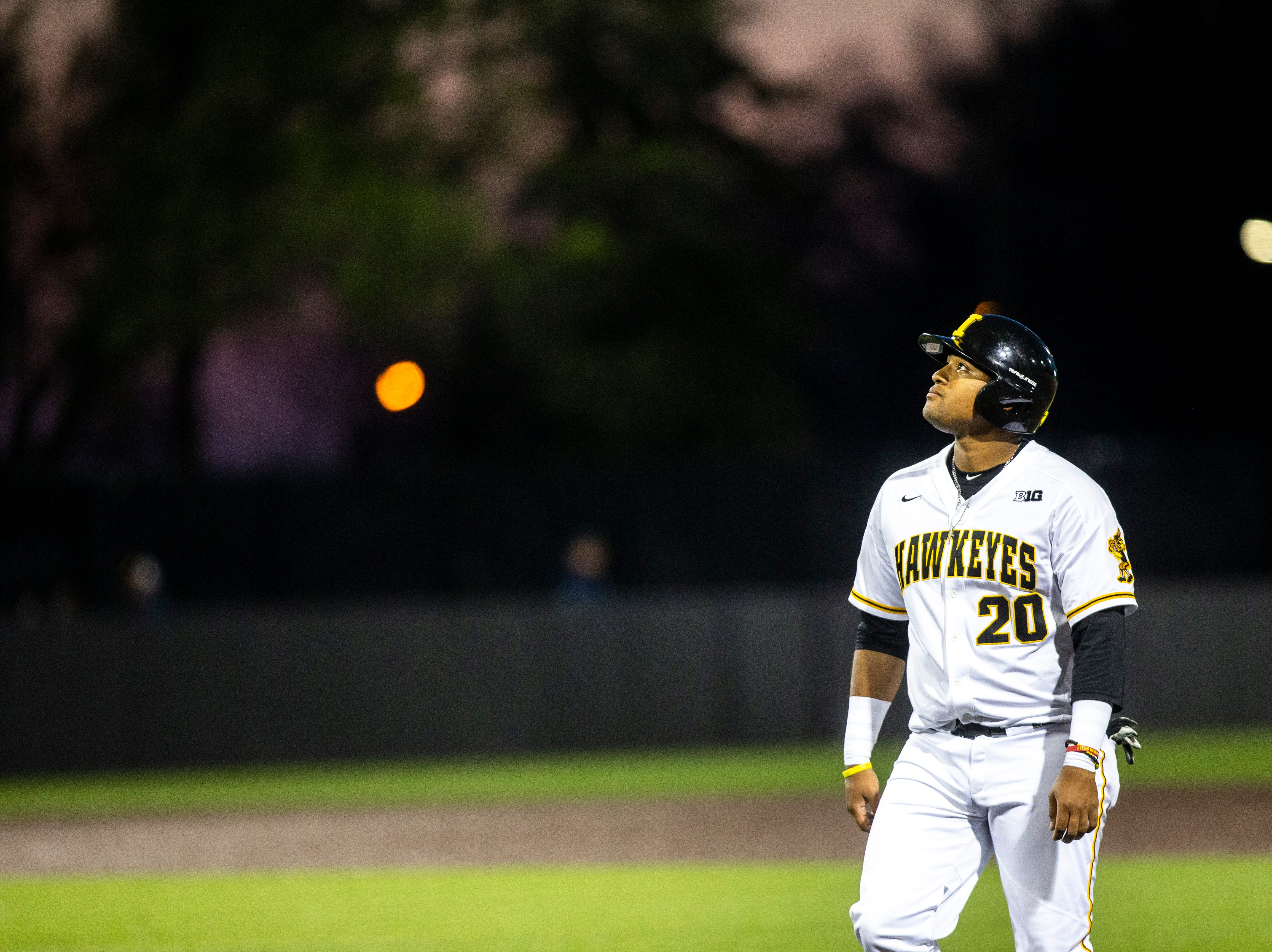 Iowa infielder Izaya Fullard (20) looks up while standing on first base as the sun sets during NCAA non conference baseball game, Friday, May 3, 2019, at Duane Banks Field in Iowa City, Iowa.