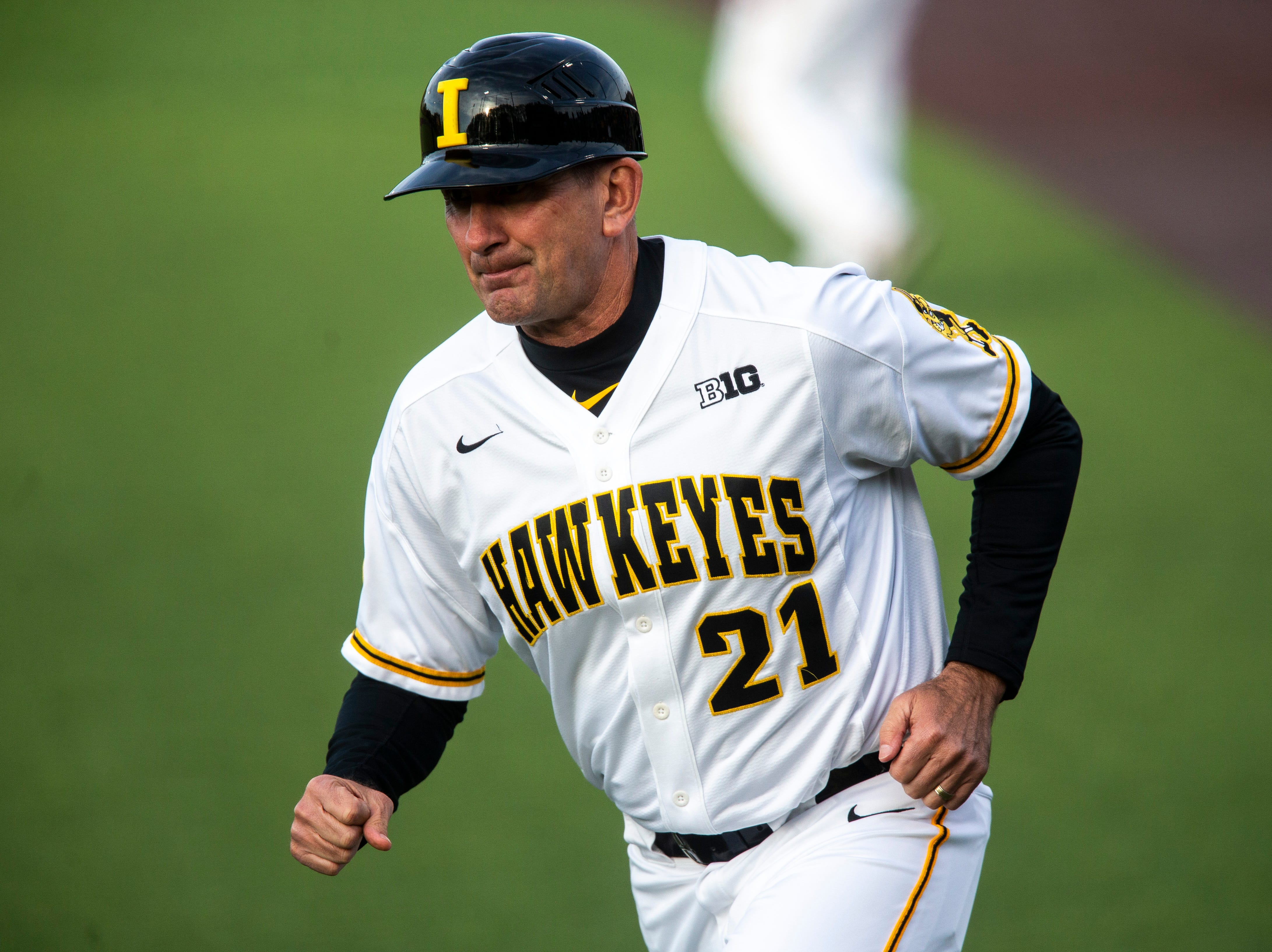 Iowa head coach Rick Heller runs out to the third baseline during NCAA non conference baseball game, Friday, May 3, 2019, at Duane Banks Field in Iowa City, Iowa.