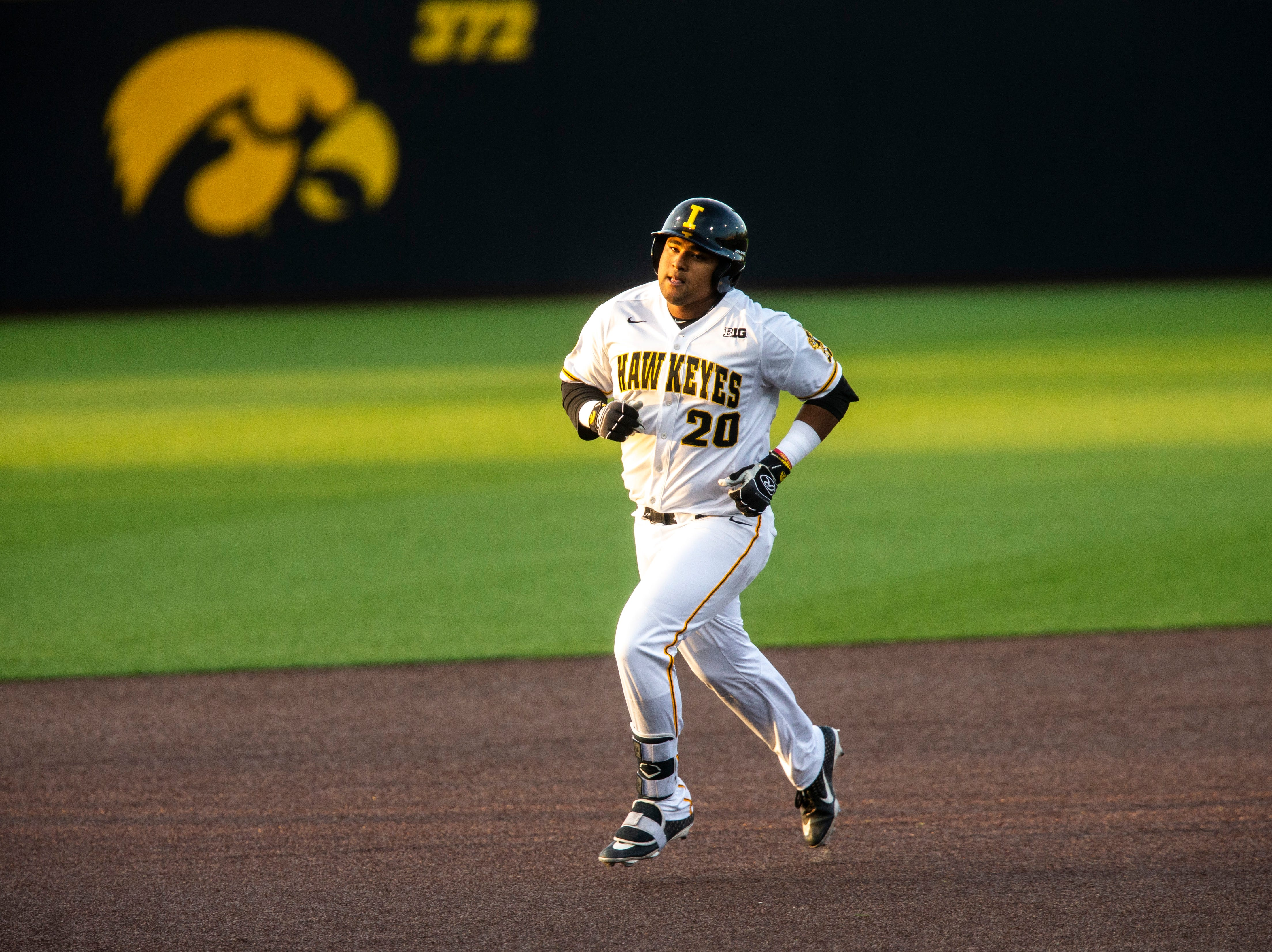 Iowa infielder Izaya Fullard (20) rounds second base after hitting a home run during NCAA non conference baseball game, Friday, May 3, 2019, at Duane Banks Field in Iowa City, Iowa.