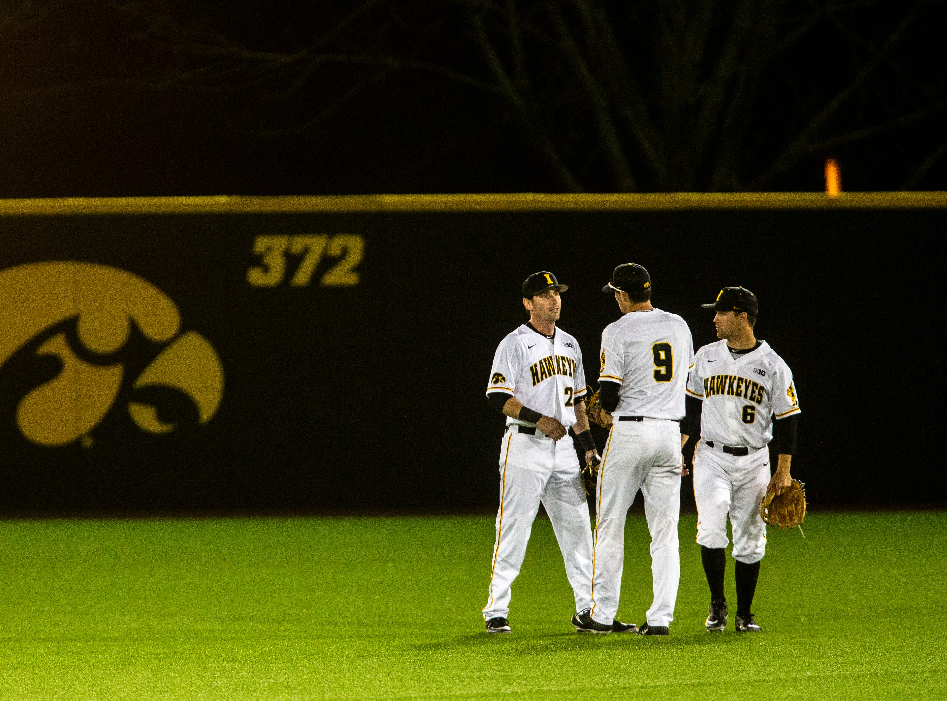 Iowa's Chris Whelan (28) meets with teammates Ben Norman (9) and Justin Jenkins (6) after catching an out in left field for the win after NCAA non conference baseball game, Friday, May 3, 2019, at Duane Banks Field in Iowa City, Iowa.