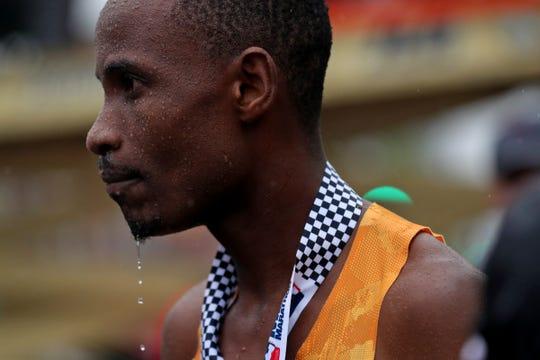Panuel Mkungo hydrates after winning the OneAmerica 500 Festival Mini-Marathon, Saturday, May 4, 2019.