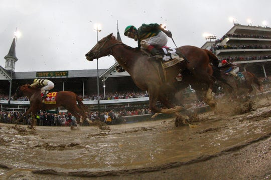 May 4, 2019; Louisville, KY, USA; Flavien Prat aboard Country House (20) races John Velazquez aboard Code of Honor (13) to the finish during the 145th running of the Kentucky Derby at Churchill Downs. Mandatory Credit: Brian Spurlock-USA TODAY Sports