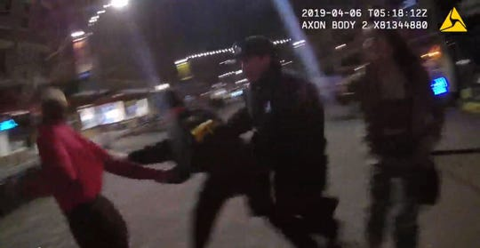 One officer trips over another before he using his taser on a Cadji Ferguson.