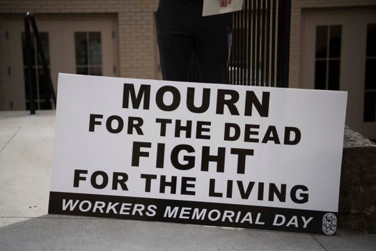 A sign is seen outside the Workers Memorial Day ceremony at the First Presbyterian Church of Knoxville in downtown Knoxville, Saturday, May 4, 2019. This year Kingston coal ash spill workers were recognized.