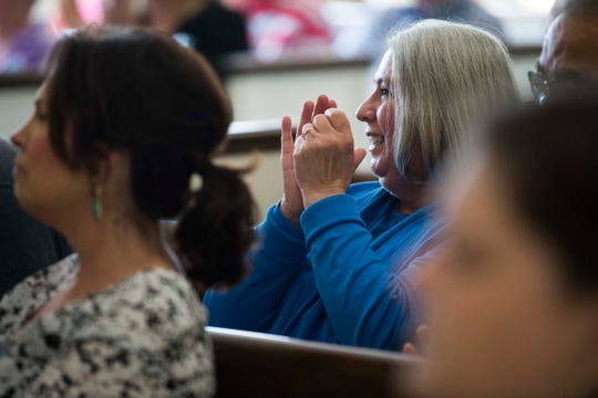 Janie Clark, wife of a Kingston coal ash worker Ansol, claps at a Workers Memorial Day ceremony at the First Presbyterian Church of Knoxville in downtown Knoxville, Saturday, May 4, 2019. This year Kingston coal ash spill workers were recognized.