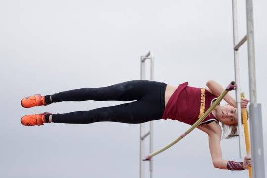 McCutcheon's Sabrina Robison breaks the North Central Conference meet pole vault record.