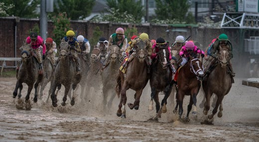 Maximum Security, second from right, bumps into other horses on the lead at the head of the stretch. Maximum Security was disqualified for interference, awarding the race to Kentucky Derby 2019 winner Country House