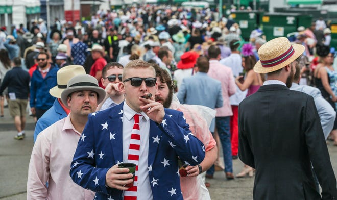 Cigars, loud suits and a ton of people start crowding into the infield May 4, 2019, at Churchill Downs for the Kentucky Derby.