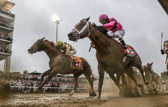 Kentucky Derby 2019 winner Country House, left, with Flavien Prat aboard, battles Maximum Security, right, in the stretch. Country House was determined the winner after an inquiry after the finish. May 4, 2019