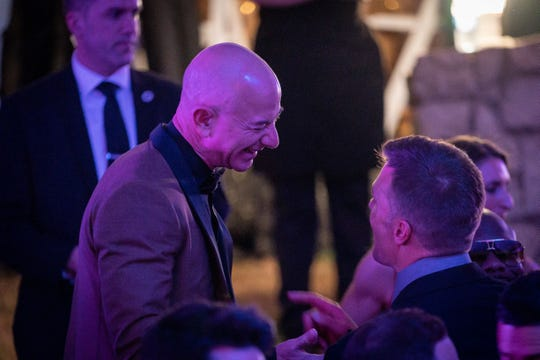 Amazon founder Jeff Bezos speaks with New England Patriots quarterback Tom Brady at the 2019 Barnstable Brown Derby Eve Gala in Louisville, Kentucky. May 3, 2019