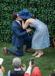 Brittany Angelini kisses Noah Walsh after he proposed to her at the 2019 Kentucky Derby.