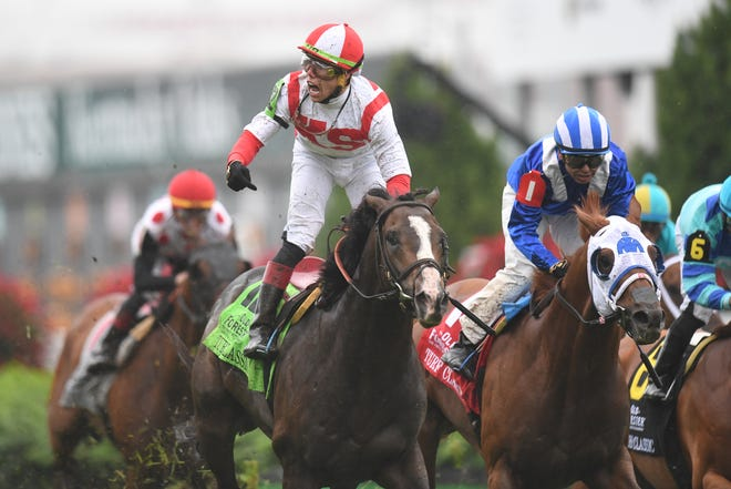 Jockey Irad Ortiz, Jr. celebrates victory in the 33rd running of the Old Forester Turf Classic aboard Bricks and Mortar at Churchill Downs in Louisville, Kentucky on Saturday, May 4, 2019.