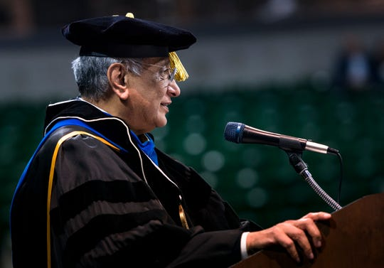 Michigan State University interim President addresses graduates Friday, May 3, 2019, during commencement ceremonies at the Breslin Center.