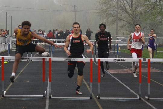 Ontario's Keandre Marlow (far left) shows his winning form in the 300 hurdles at Friday's Galion Invitational