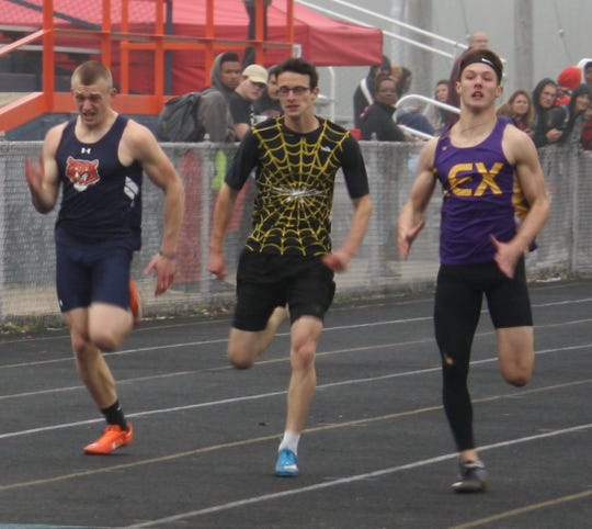 Lexington's Alex Green beats Galion's Colbey Fox (far left) and Bradley Kussmaul of Watkins Memorial to the finish line in the 200 at Friday's Galion Invitational