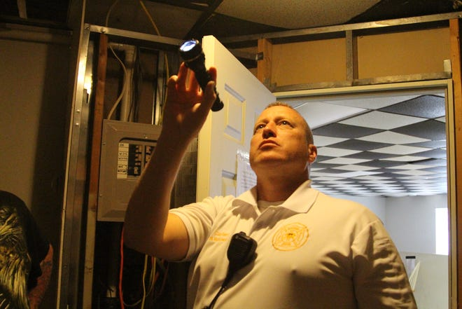 Marion City Fire Inspector Mike Makowski inspects a residential unit Thursday for fire hazards and other code violations. Makowski says there have been too many fires without working smoke detectors in Marion.