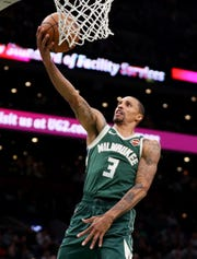 Bucks guard George Hill scores against the Celtics during the second half of Game 3.