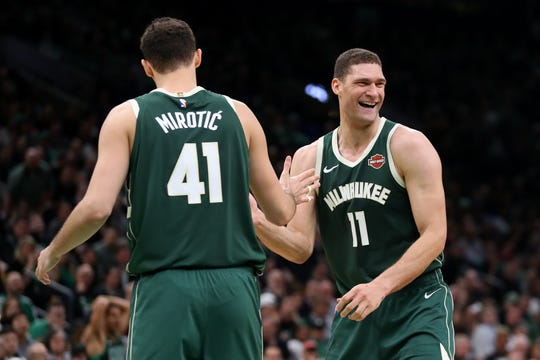 Brook Lopez  celebrates with Nikola Mirotic in the second half Friday night.