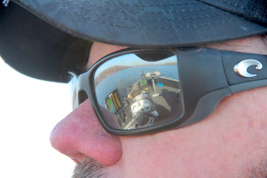 A view of the front of his boat and Dairyland Flowage is reflected in John Carlson's sunglasses on Saturday, May 4, 2019, opening day of the 2019 Wisconsin inland fishing season.