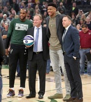 Milwaukee Bucks GM Jon Horst (far right) poses for a photo with (from left) forward Khris Middleton, head coach Mike Budenholzer and Giannis Antetokounmpo as they are recognized at Fiserv Forum in February before taking part in the NBA All-Star Game festivities later that month.