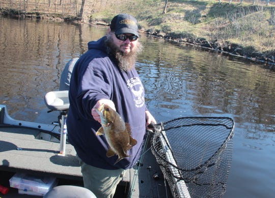 John Carlson of Phillips holds a smallmouth bass caught while fishing Saturday on the Dairyland Flowage near Ladysmith. Saturday was opening day of the 2019 Wisconsin inland fishing season.