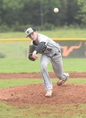 Izard County's Gunner Gleghorn delivers to the plate against Hillcrest.