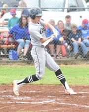 Izard County's Chase Orf connects on a double.