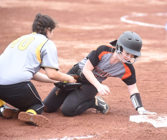 Calico Rock's Camryn Cook gets back to third base during the Lady Pirates' win over Maynard on Friday.