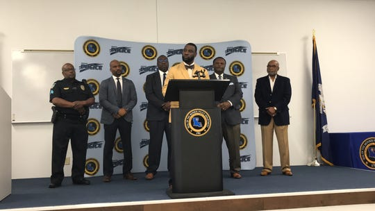 Youth Services Coordinator Jason Stewart was introduced at a April 25 press conference held at Monroe Police Department headquarters. Also pictured are Sgt. Larry Wilson, Public Information Officer Reggie Brown, Chief Eugene Ellis, Mayor Jamie Mayo and Crime Consultant Curtis Spears.