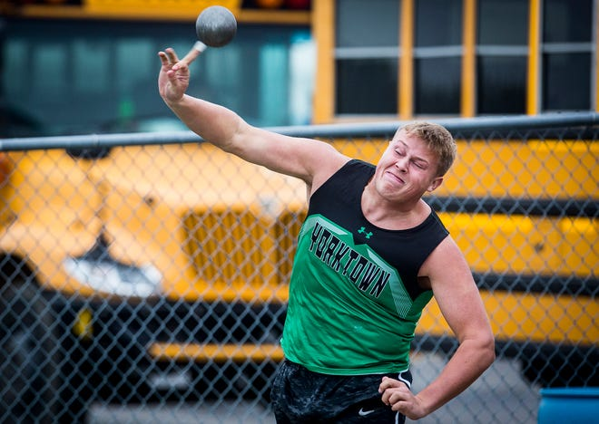 Yorktown's Walker Moore competes in the shot put during the Delaware County Track Meet at Delta High School Friday, May 3, 2019.
