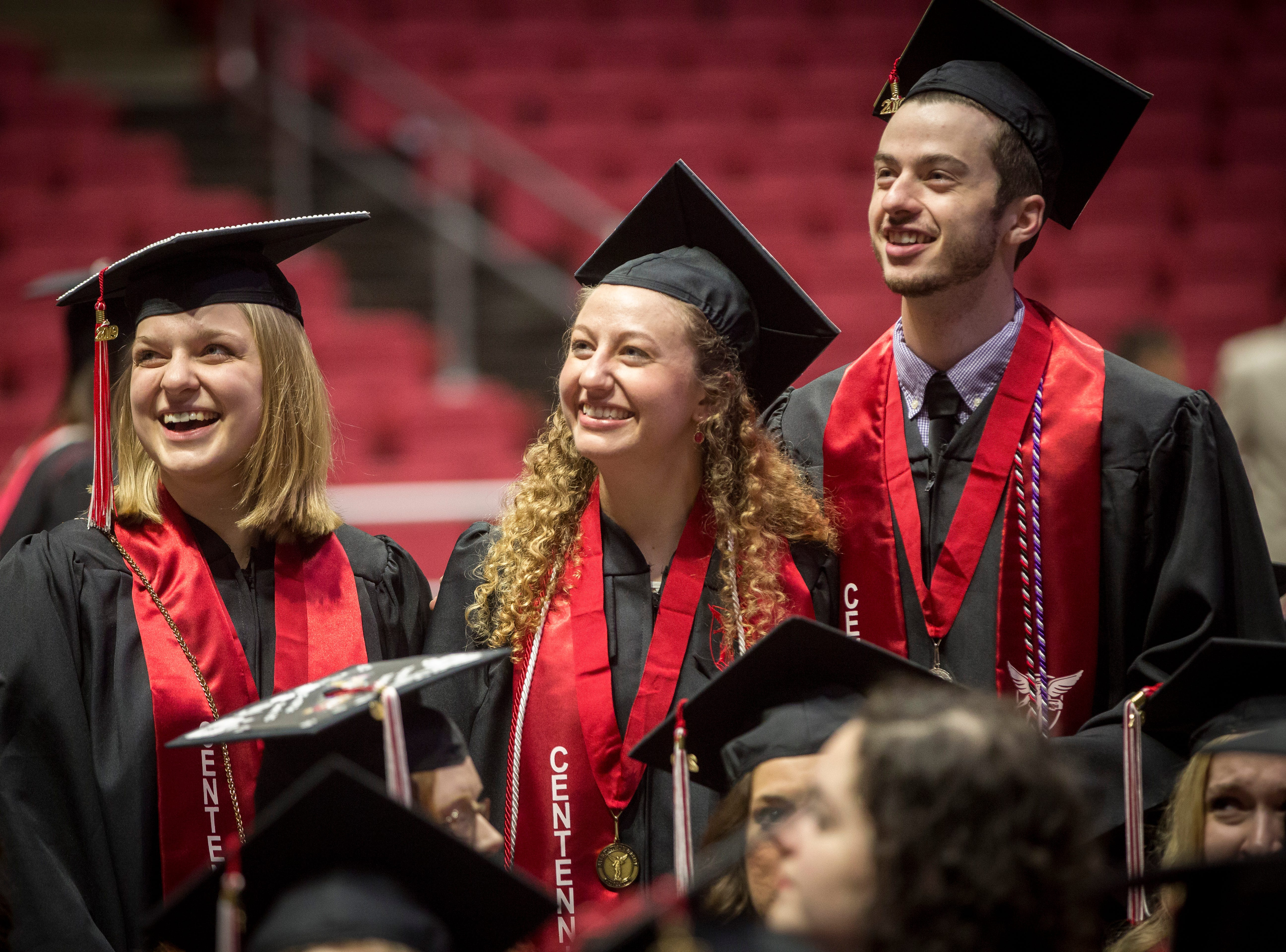 Graduates gather on the floor of the stadium and look for friends and family on May 4 before the start of Ball State University's Spring Commencement inside Worthen Arena. Due to bad weather the ceremony was moved last minute to the university's basketball stadium.