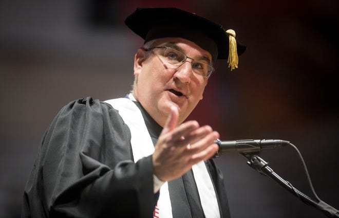 Indiana Governor Eric Holcomb gives words of advice to the new graduates on May 4 during Ball State University's Spring Commencement inside Worthen Arena. Holcomb urged the new graduates to stay in Indiana as they begin their new careers and lives.