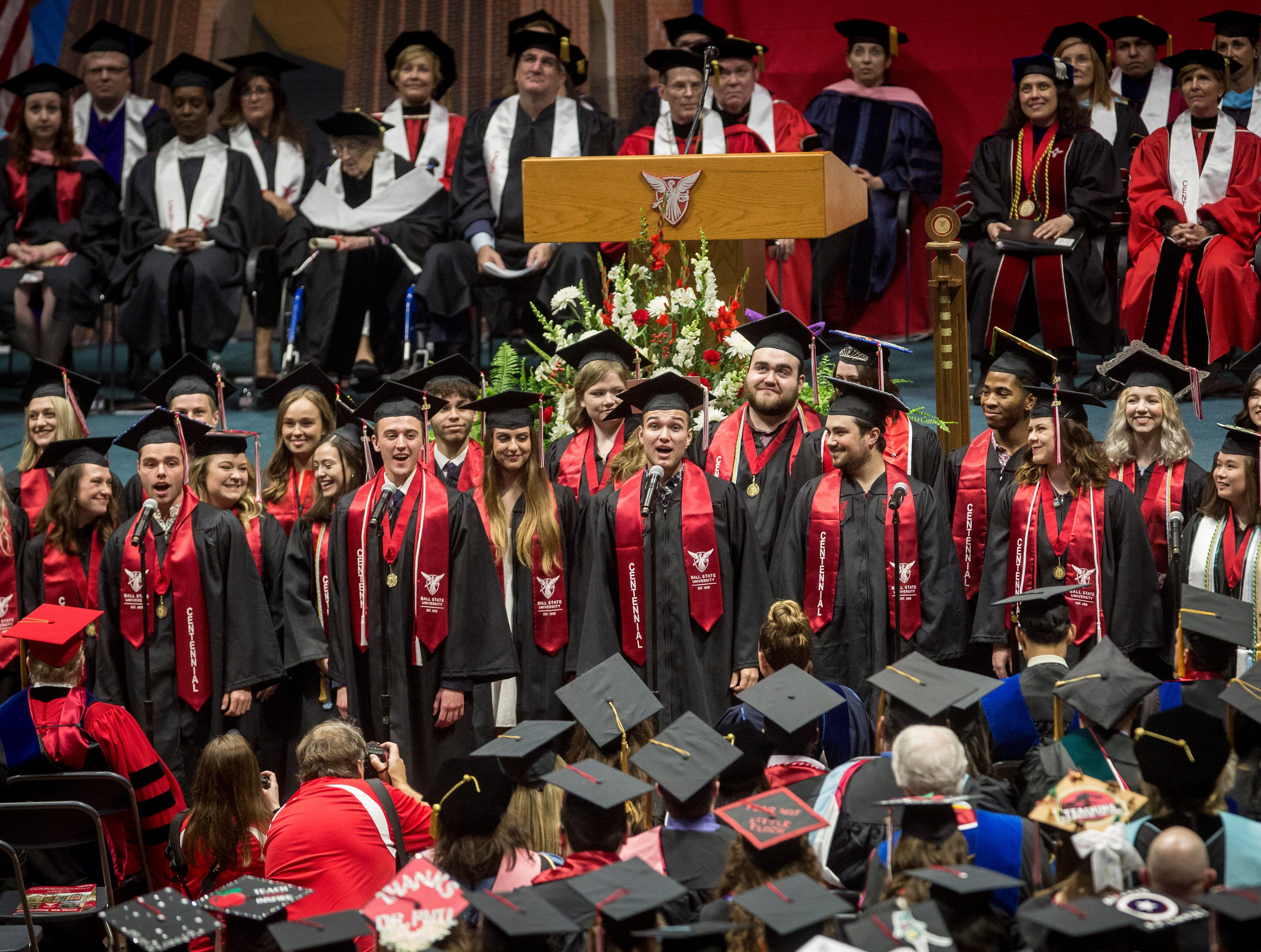 Ball State students provide a musical number commissioned in honor of the university's centennial on May 4 during Ball State University's Spring Commencement inside Worthen Arena.