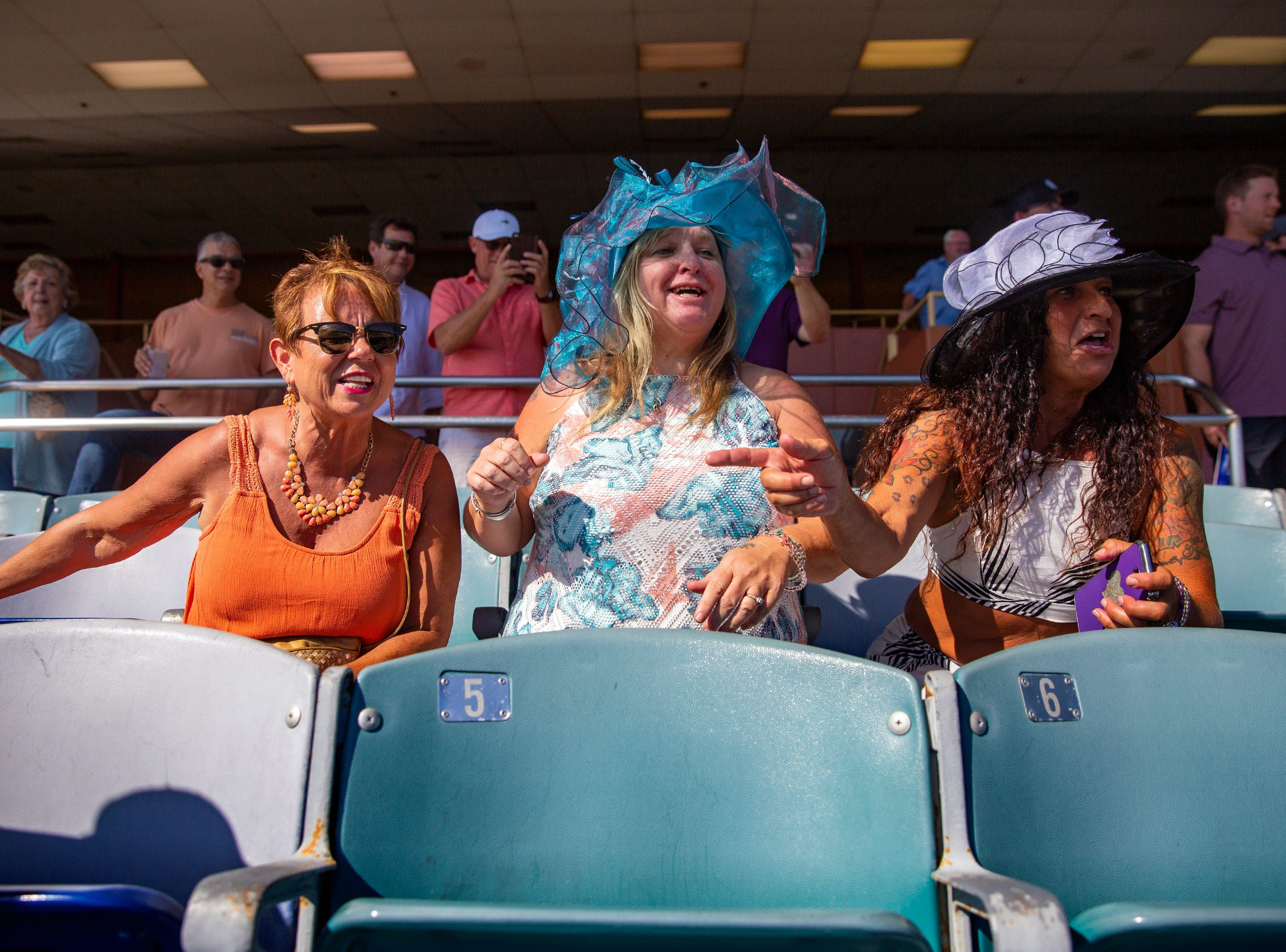 Sharon Workley, left, Leeanna Parsons and Venassa Cordovano cheer on their dog during a race, Saturday, May 4, 2019, at Naples Fort Myers Greyhound Racing and Poker in Bonita Springs.