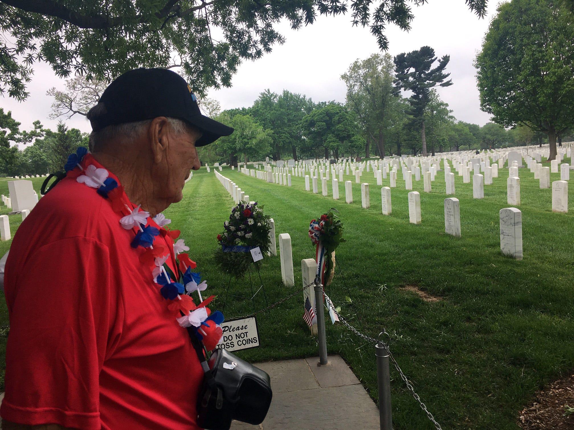 World War II veteran Edwin McQuiston surveys graves at Arlington National Cemetery on Saturday, May 4, 2019.