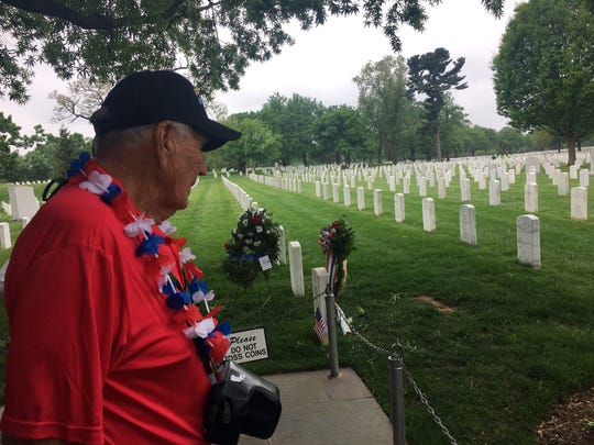 World War II veteran Edwin McQuiston surveys graves at Arlington National Cemetery on Saturday, May 4, 2019.