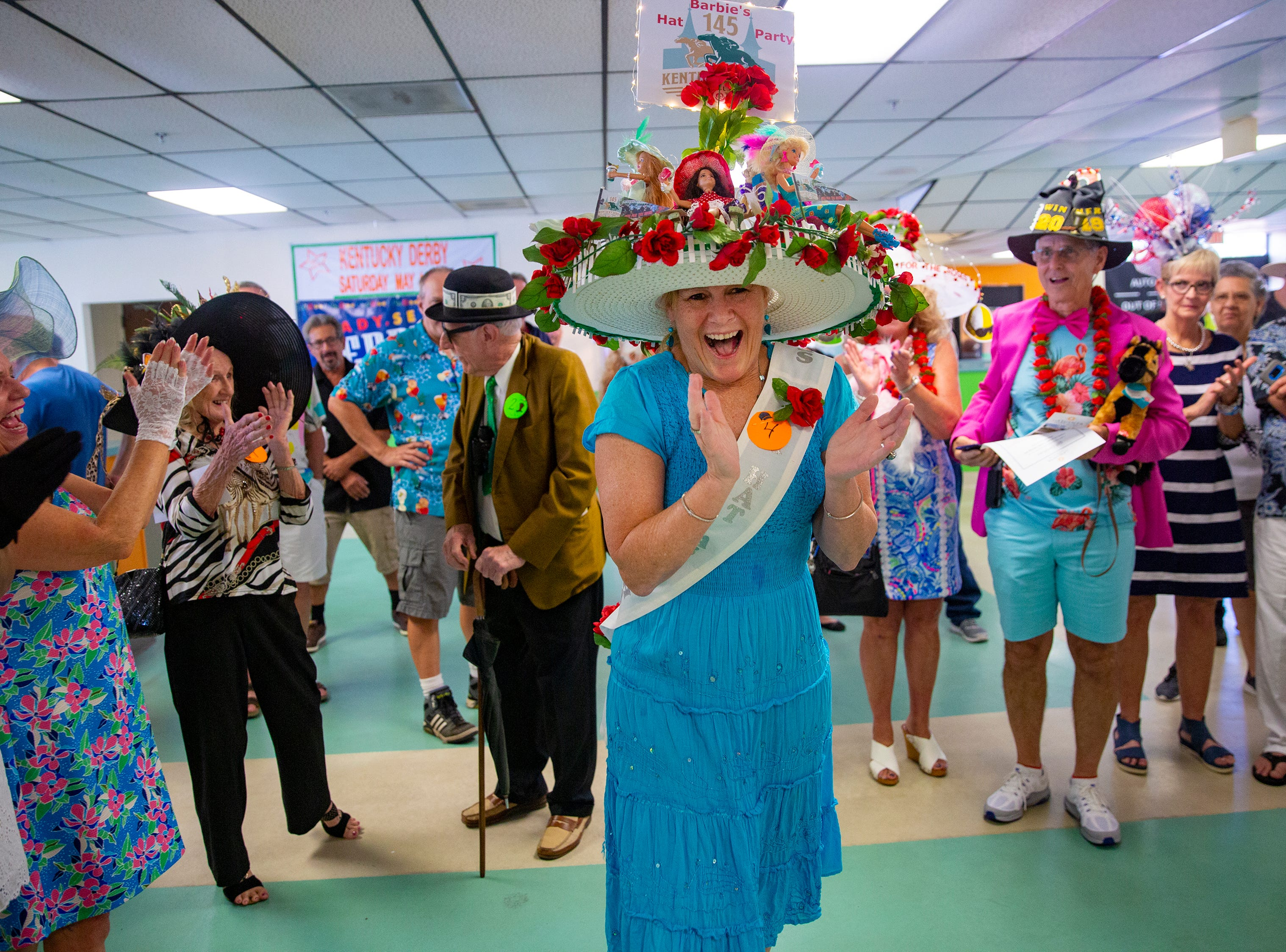 Sandy Gross reacts after winning the annual Best Derby Hat competition, Saturday, May 4, 2019, at Naples Fort Myers Greyhound Racing and Poker in Bonita Springs.