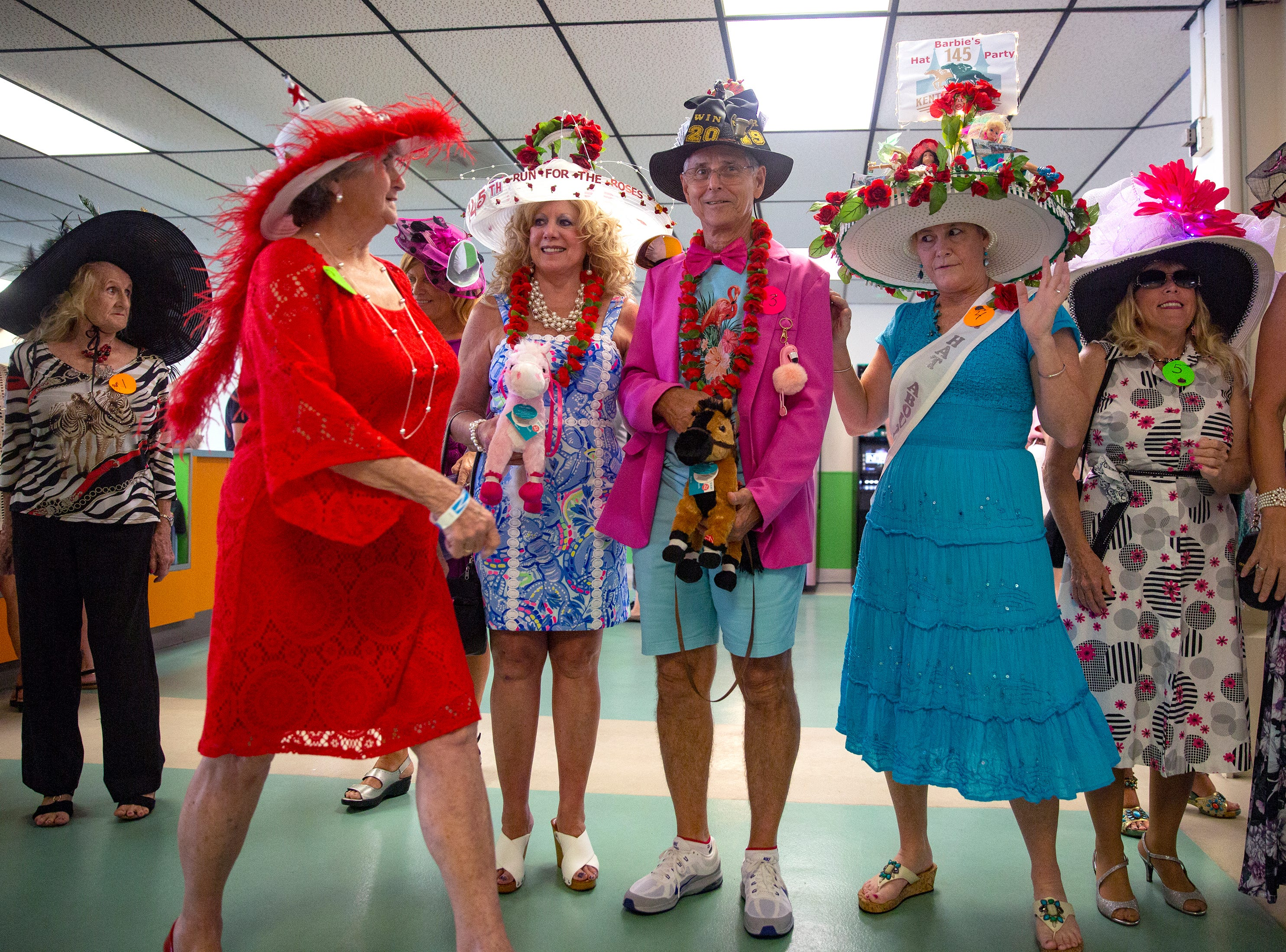 Contestants in the Best Derby Hat competition prepare to be judged during the annual  Best Derby Hat competition, Saturday, May 4, 2019, at Naples Fort Myers Greyhound Racing and Poker in Bonita Springs.