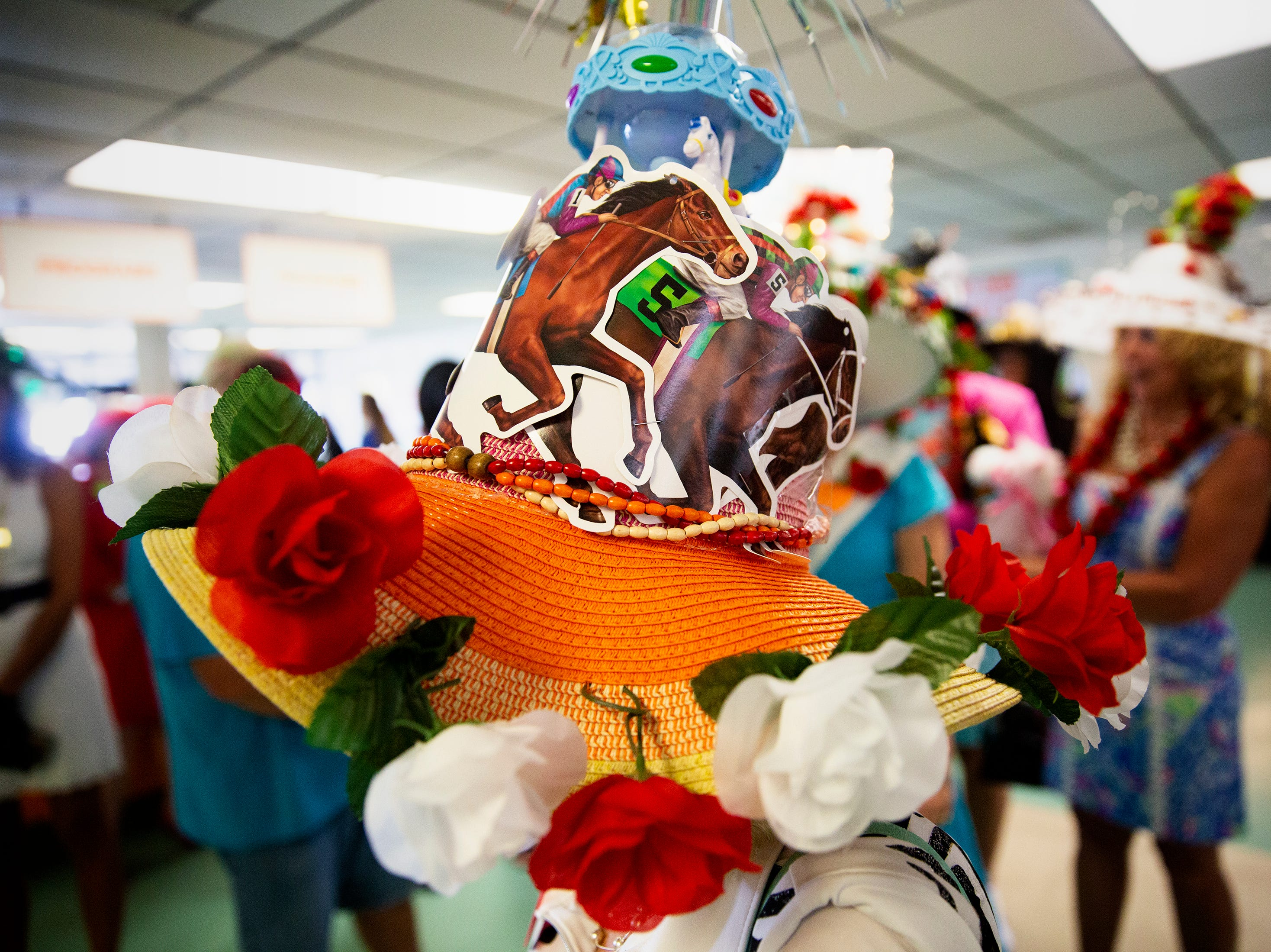Susan McDonald of Fort Myers shows off her hat during the annual Best Derby Hat competition, Saturday, May 4, 2019, at Naples Fort Myers Greyhound Racing and Poker in Bonita Springs.