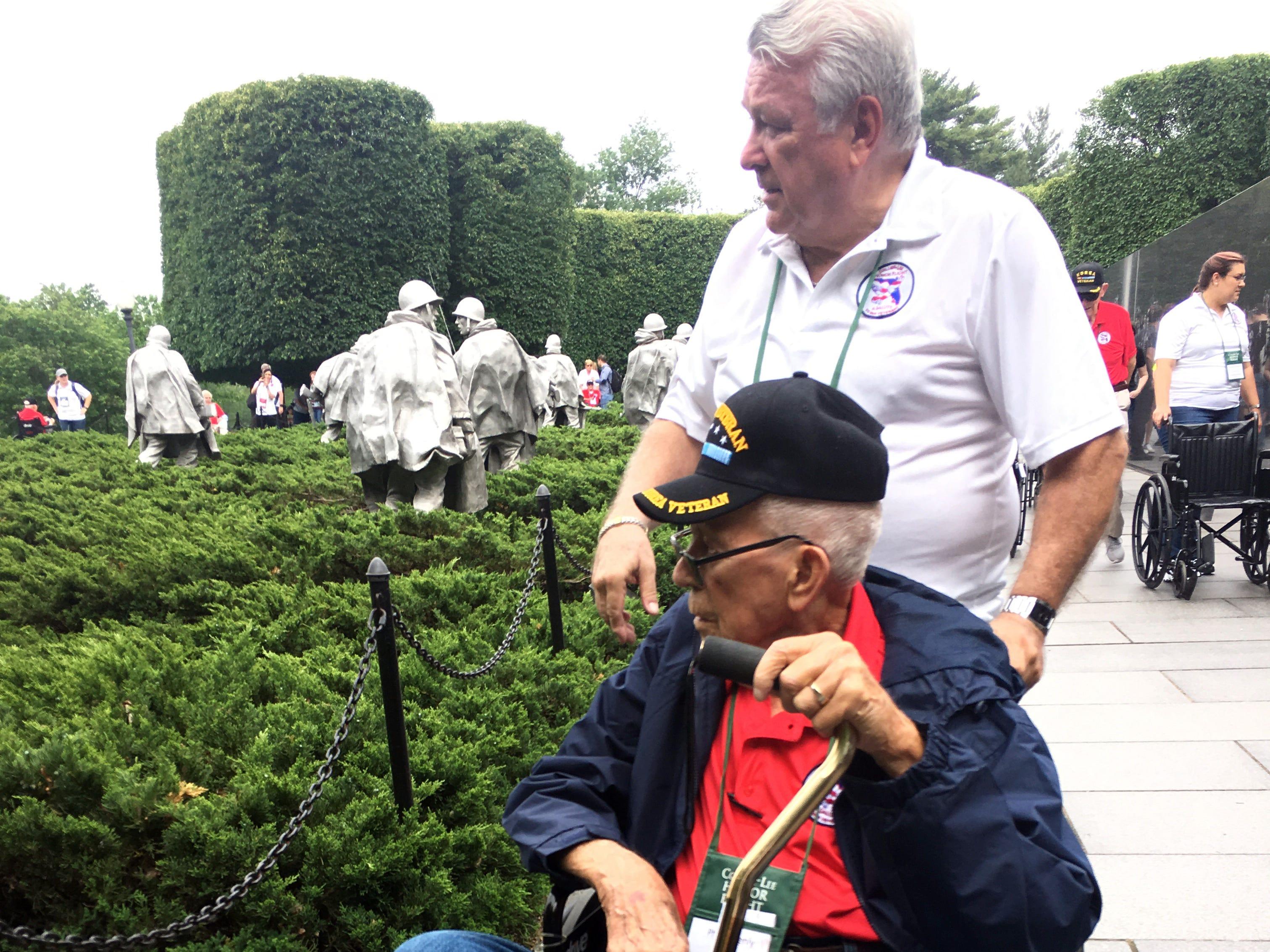 Korean War veteran Philip Keenly of Naples and Honor Flight guardian Al Ambrose look at the Korean War Memorial in Washington, D.C. on Saturday, May 4, 2019.