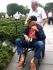 Korean War veteran Philip Keenly of Naples and Honor Flight guardian Al Ambrose look at the Korean War Memorial in Washington, D.C. on Saturday, May 4, 2019.
