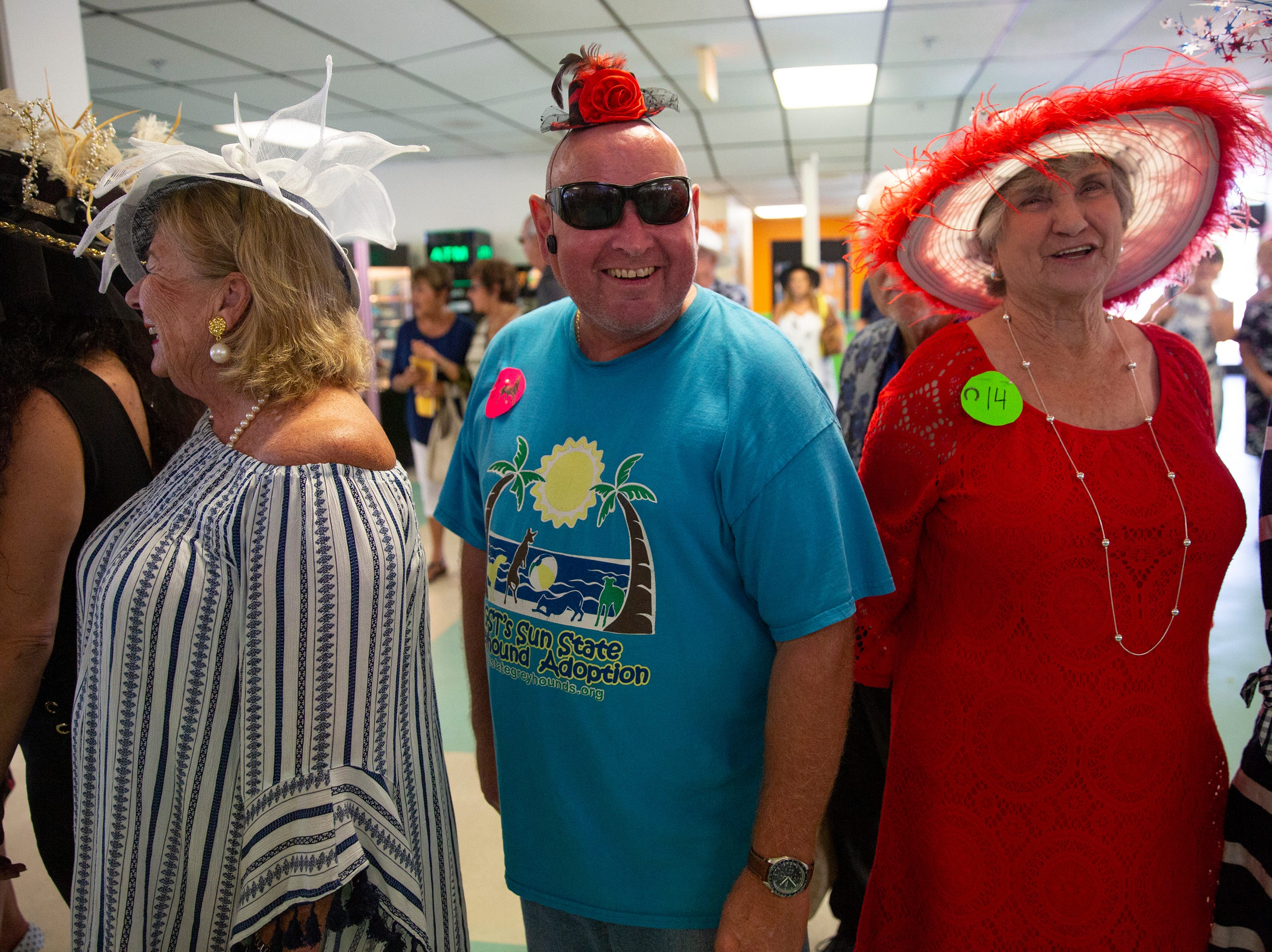 Brian Dippel of Bay City, Florida, enters the annual Best Derby Hat competition with a tiny hat, Saturday, May 4, 2019, at Naples Fort Myers Greyhound Racing and Poker in Bonita Springs.
