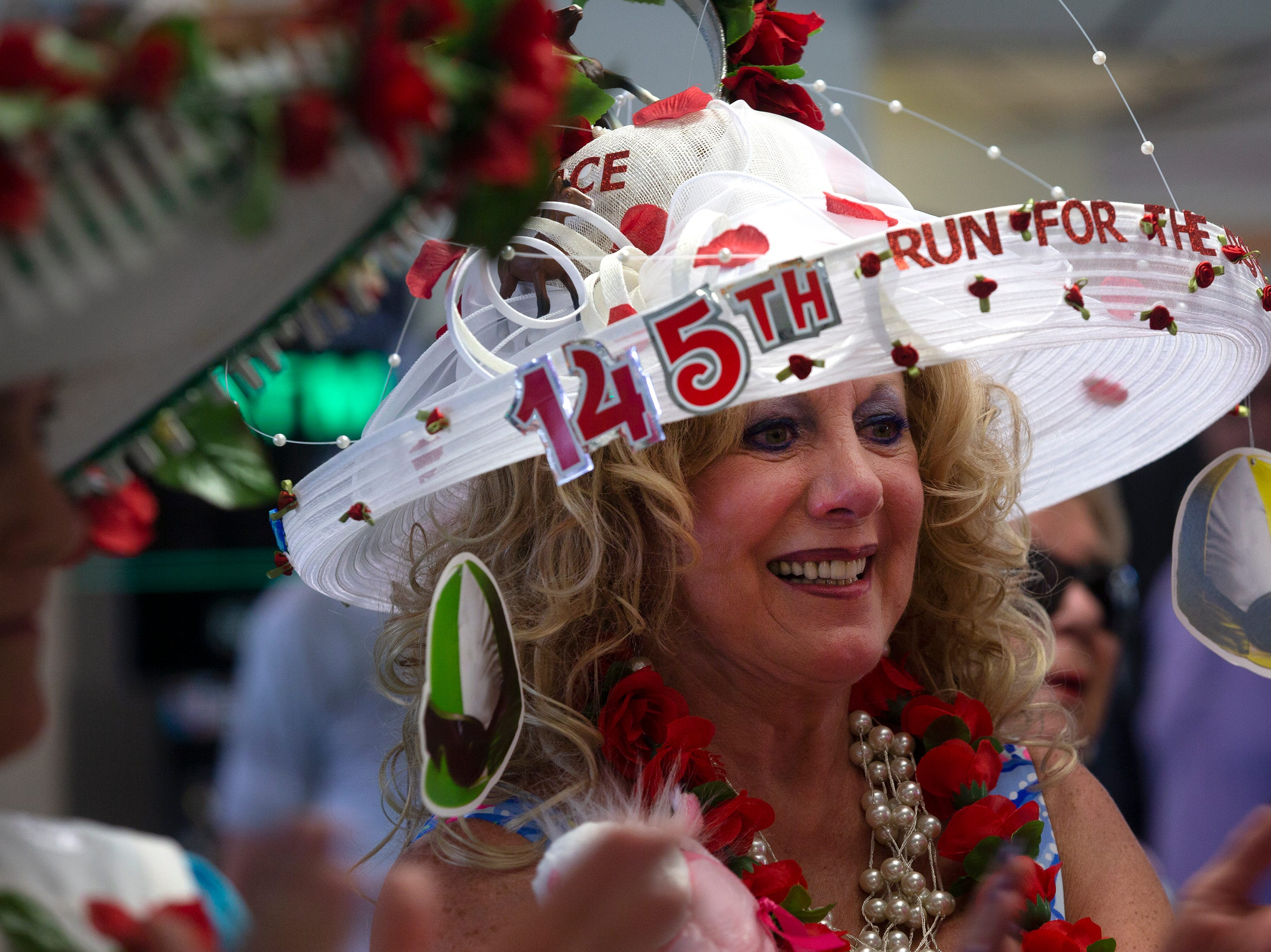 Karen East of Estero participates in the annual Best Derby Hat competition, Saturday, May 4, 2019, at Naples Fort Myers Greyhound Racing and Poker in Bonita Springs.