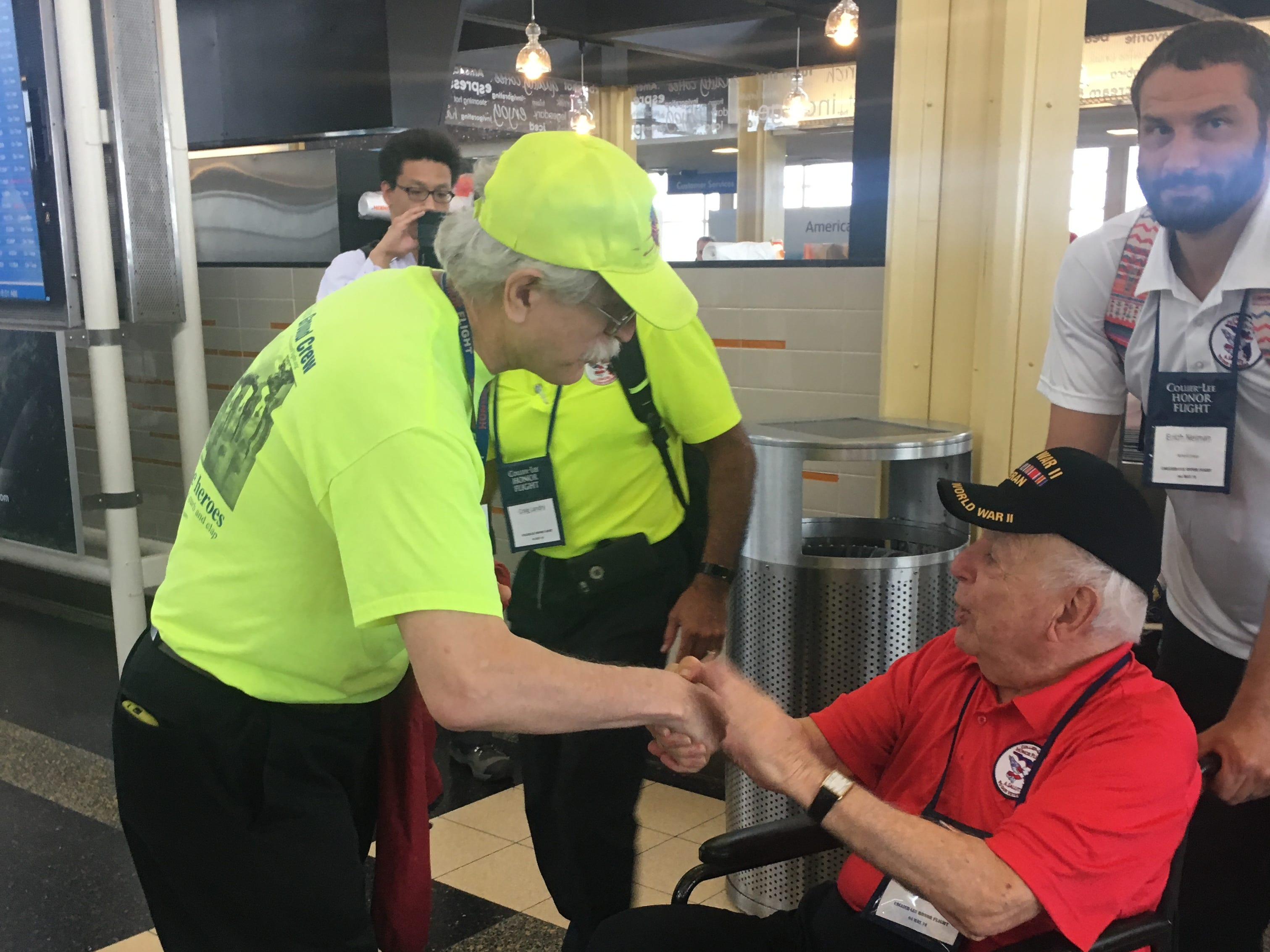 David Benbennick, an Honor Flight volunteer from Vienna, Virginia, greets Arnold Levy Saturday, May 4, 2019, in Washington, D.C. Benbennick says he's greeted thousands of Honor Flights over the years.